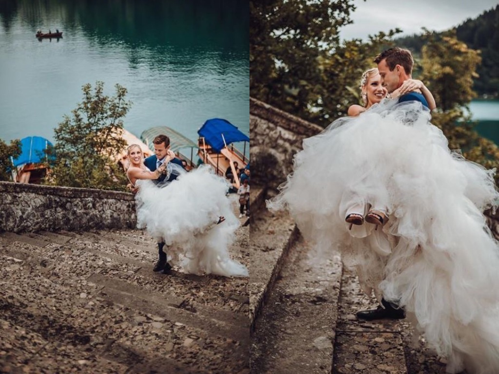 A bride follows tradition and is carried up the stairs at Lake Bled, Slovenia