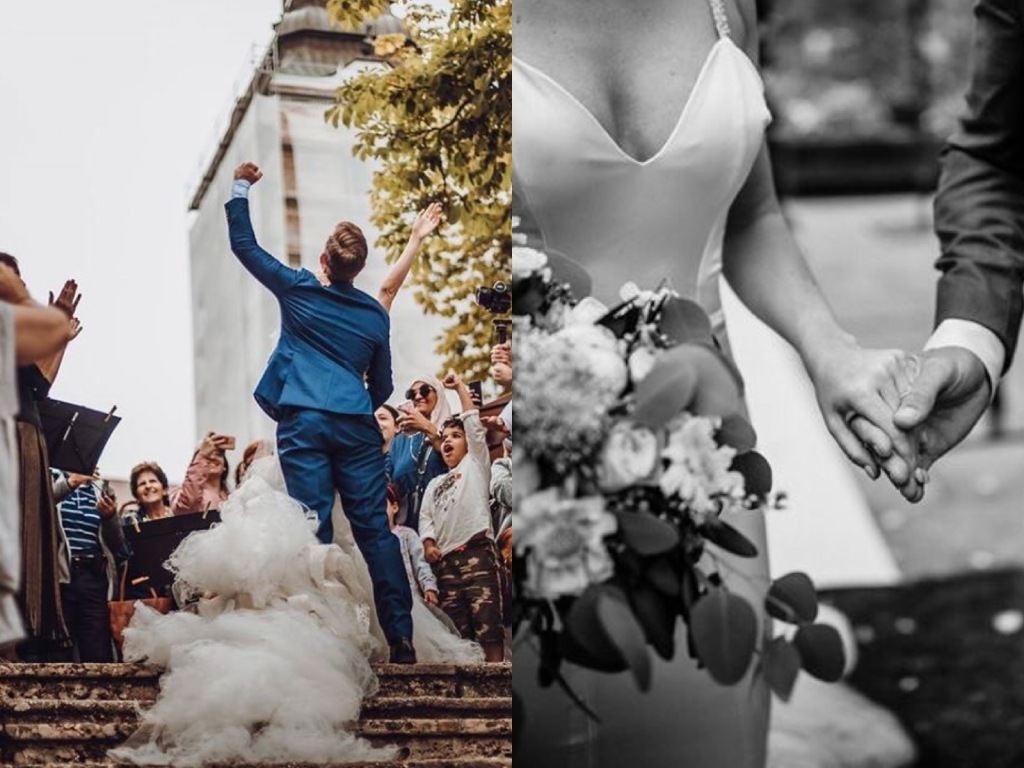 A groom celebrates carrying his bride up the stairs at Lake Bled, Slovenia