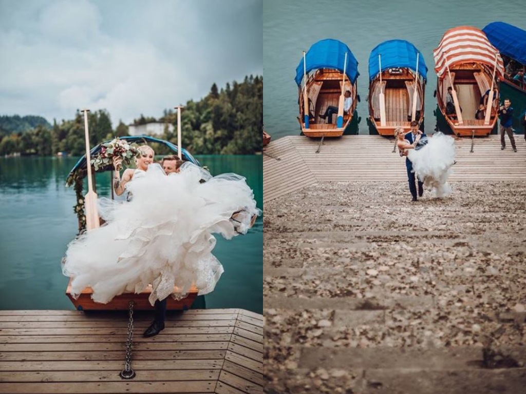A bride gets carried up the stairs at Lake Bled, Slovenia